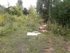 Свалка мусора в частном секторе на заброшенном участке в мкр Губайлово, г. Красногорск.